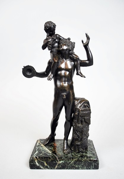 A satyr with cymbals carrying Bacchus on his shoulder, Grand Tour bronze after the antique