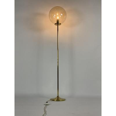 Brass floor lamp with glass globe