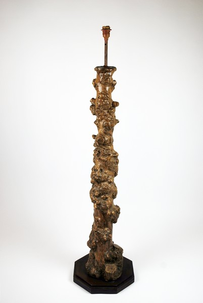 Lamppost base formed from a vine stump