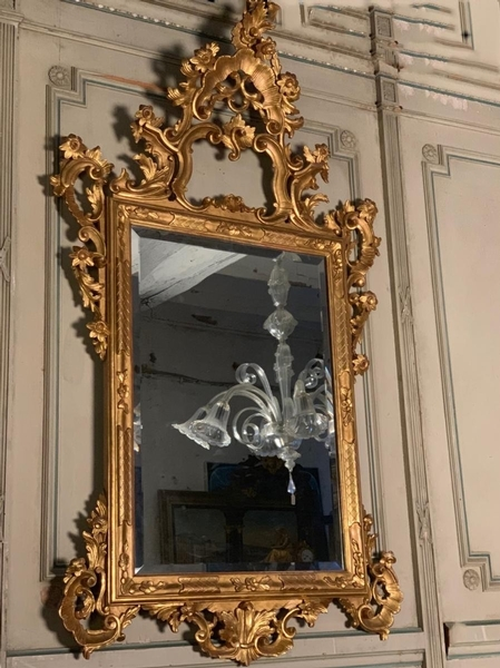 Louis XV style carved and giltwood mirror