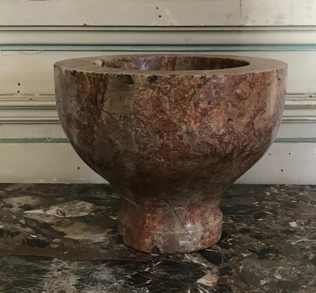 Orange marble mortar