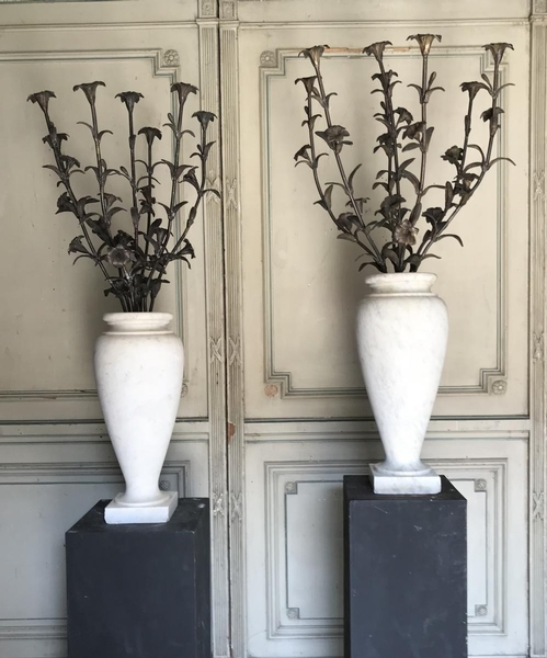 Pair of carrara marble vases with bronze flowers