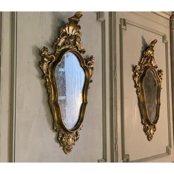 Pair of carved and gilded mirrors
