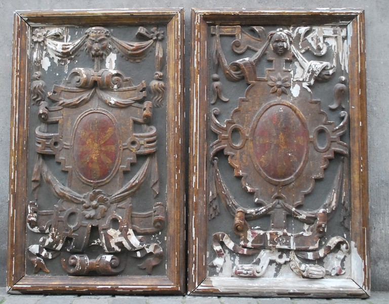 Pair of carved and painted low relief, late 17th C. / early 18th C.