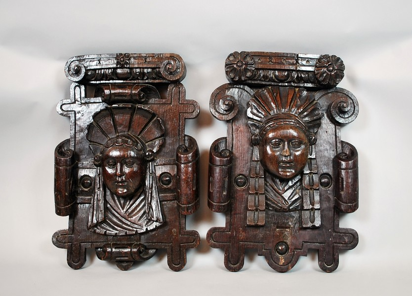 Pair of carved wooden commercial signs, late 17th C.