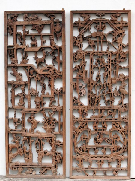 Pair of carved wooden decorative panels