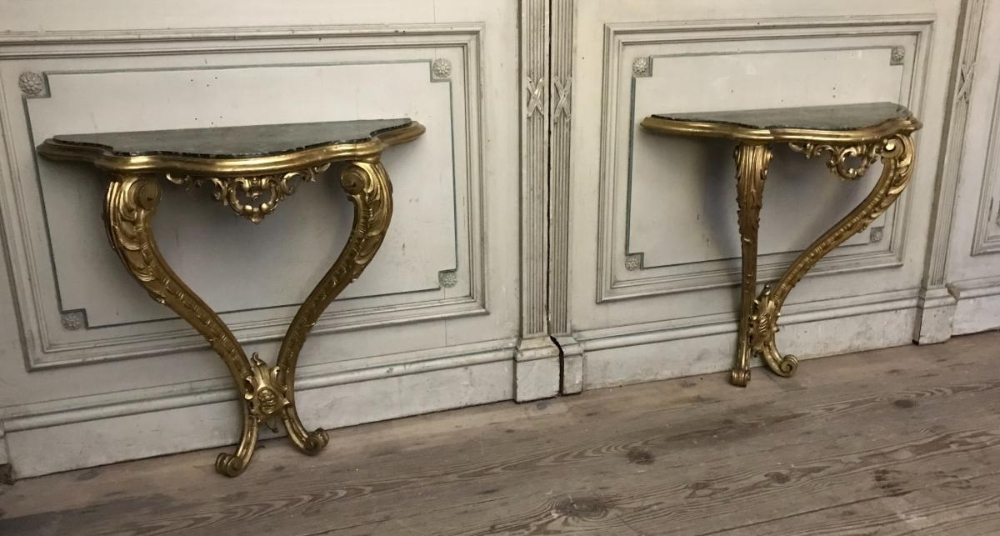 Pair of Louis XV style carved and giltwood consoles