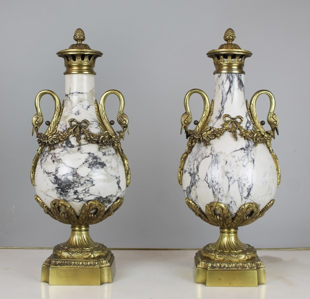 Pair of marble and gilt bronze casseroles.