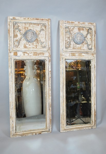 Pair of patinated mirrors
