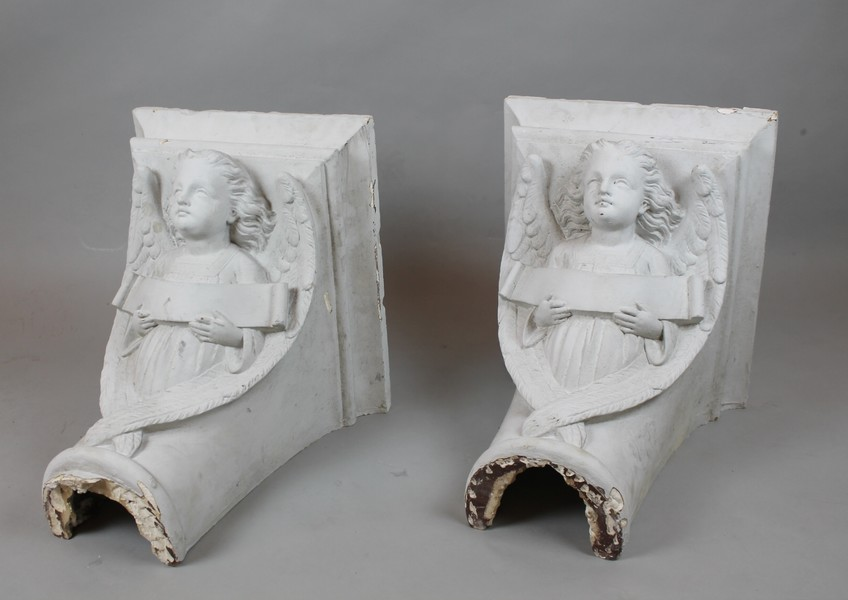 Plaster console decorated with angels