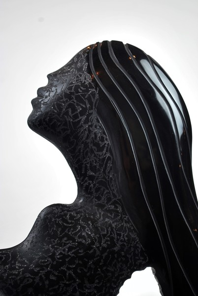 Profile of a woman in black murano glass, circa 1970's