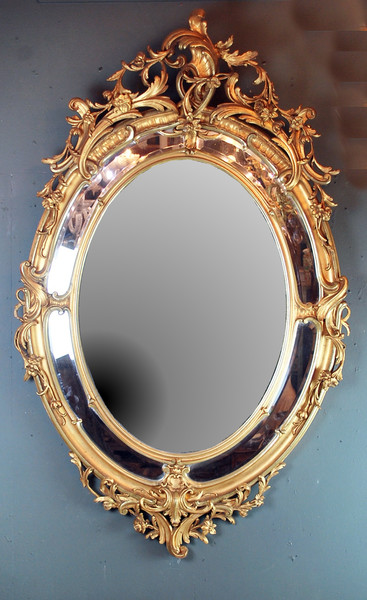 Richly decorated Louis XV style mirror