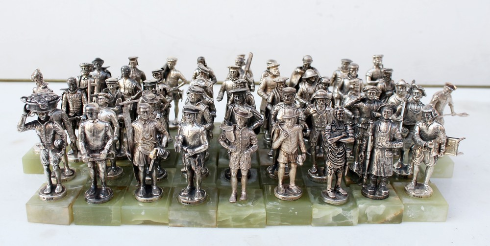 Set of 48 silver sculptures on onyx bases depicting the sculptures of Petit Sablon Square in Brussels