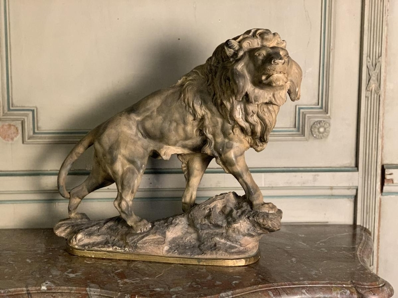 Terracotta lion sculpture, signed Amorgasti